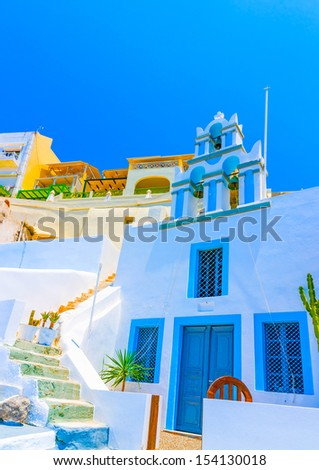Old traditional narrow stone made street in Fira the capital of Santorini island in Greece - stock photo