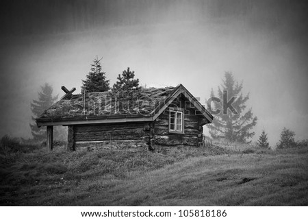 Old traditional Norway house at foggy morning.