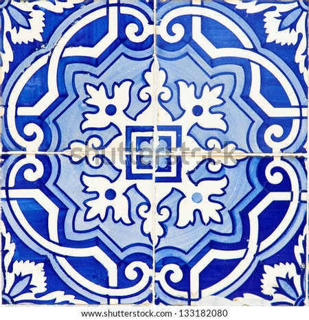 Old Traditional Portuguese azulejos, painted ceramic tilework - stock photo