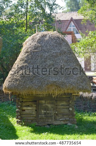 Old traditional romanian barn with straw roof
