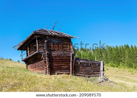 Old traditional Udmurt wooden house near the forest