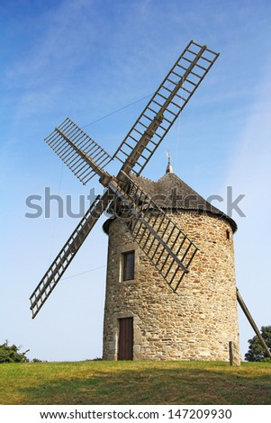 Old traditional windmill in Normandy, France