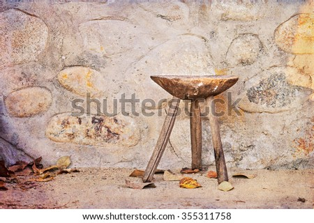 Old traditional wooden chair in romanian countryside - stock photo