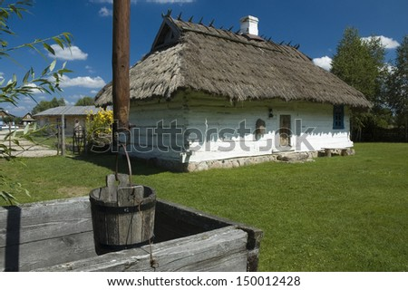 Old, traditional wooden cottage house in a village in Bialowieza, Poland - stock photo