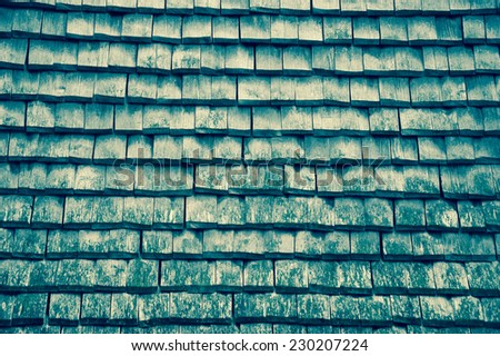 Old traditional wooden tiled roof. Aged photo. - stock photo
