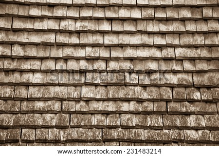 Old traditional wooden tiled roof. Aged photo. Sepia. - stock photo