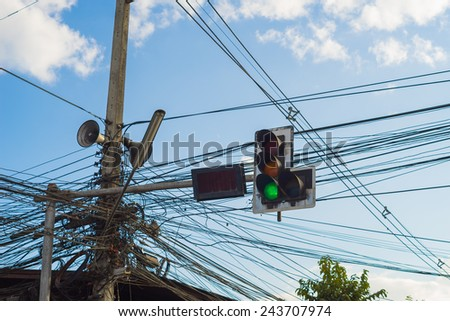 Old traffic light with tangled  electric wire. - stock photo