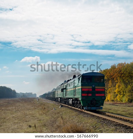 old train and smoke over it - stock photo