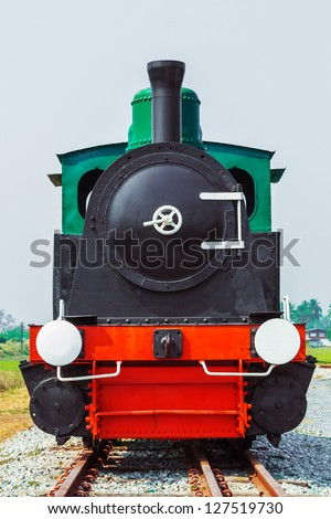 Old train on rusty railway - stock photo