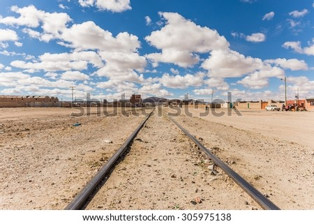 old train rails in uyuni bolivia - stock photo