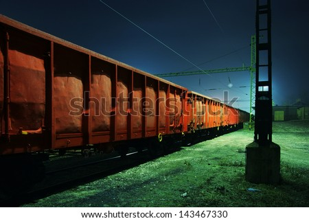 Old train wagons at night - stock photo