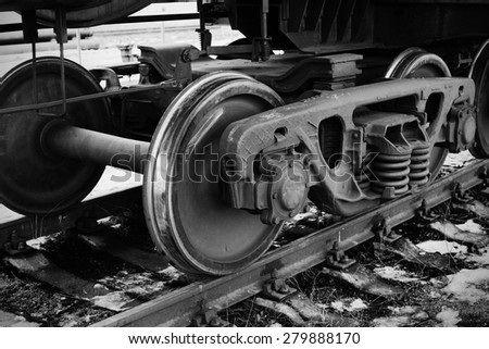 Old train wheel on a old track - stock photo