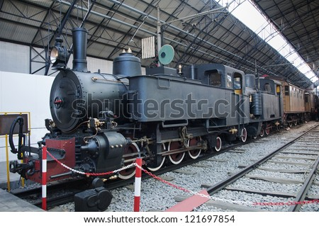 Old train with steam engine locomotive - stock photo