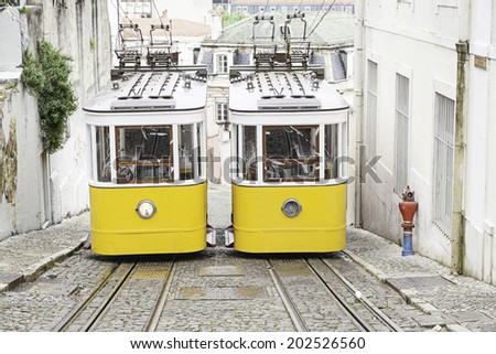 Old trams in Lisbon, detail of an old city transport, ancient art, tourism in the city - stock photo