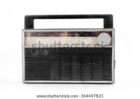 Old transistor radio isolated on white .