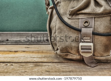 old travel backpack on the floor - stock photo