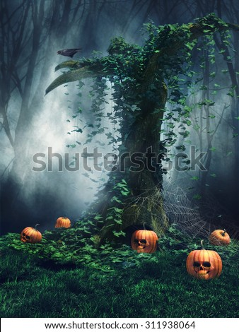 Old tree in a forest with a raven, cobwebs and Halloween pumpkins - stock photo