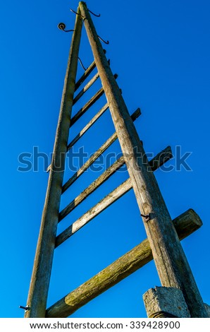 old triangle electricity wooden pole with blue sky