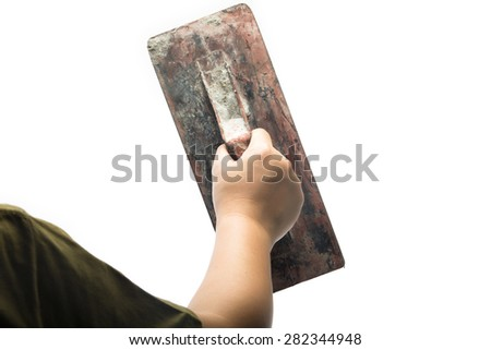 Old trowel in  hand isolated on white background - stock photo