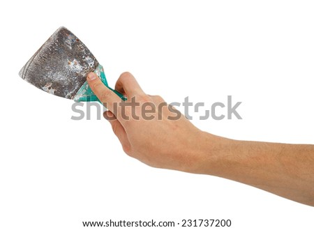 Old trowel in male hand isolated on white background - stock photo