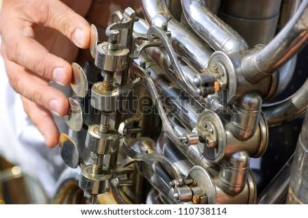 Old tuba mechanism - stock photo