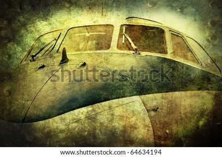Old turboprop aircraft closeup, grunge background - stock photo