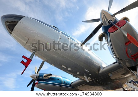 Old turboprop airplane seen from below - stock photo