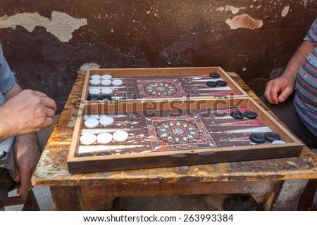 Old turkish men playing backgammon, Istanbul - stock photo