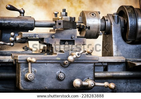 old turning lathe at an antique workshop - stock photo