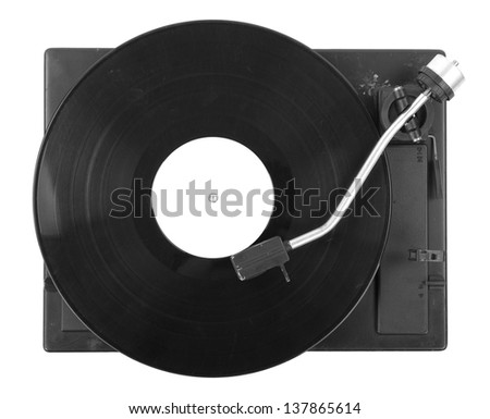 Old turntable with vinyl record - stock photo