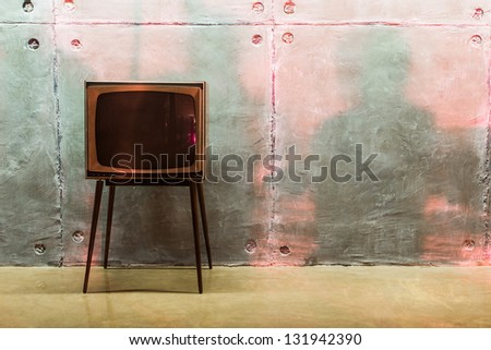 old TV and shadows on the wall in the studio - stock photo