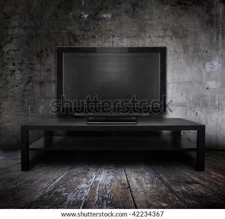 old tv in grunge interior - stock photo