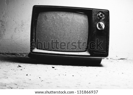 Old TV in room. Black and white film style colors.