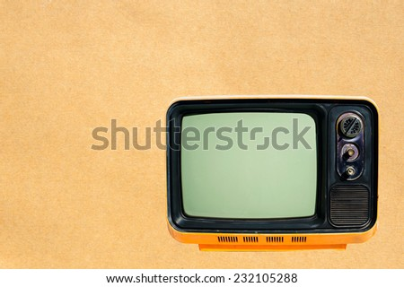 old tv on paper background - stock photo
