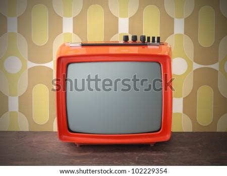 Old TV on vintage background - stock photo
