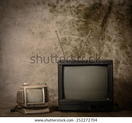 Old tv with grunge background - stock photo