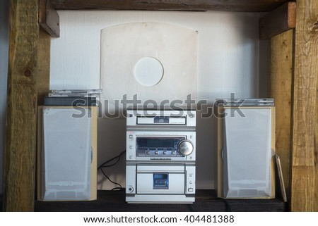 Old type stereo cassete player on wood shelf - stock photo