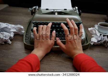 Old typewriter, human hands, ready for jounalist action  - stock photo