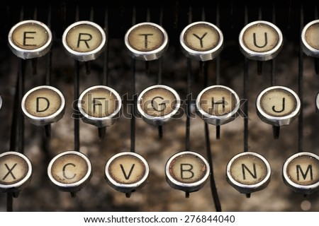 old typewriter keyboard predecessor of the electric typewriter and keyboard pc - stock photo