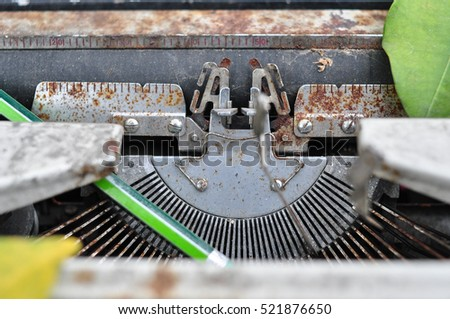 Old typewriter on a wooden table
