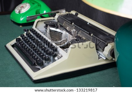 Old typewriter on the vintage table