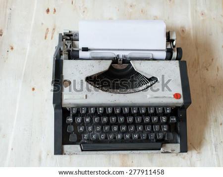 Old Typewriter on wooden table. - stock photo
