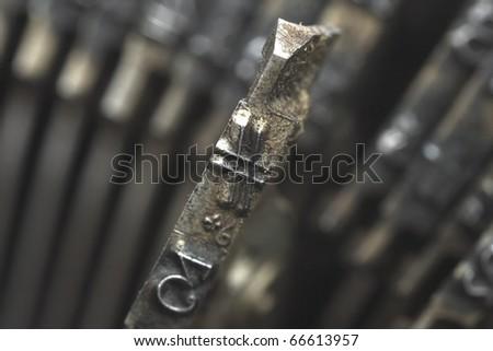 Old typewriter type with focus on number symbol - stock photo