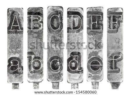 Old Typewriter Typebar Letters A to F Isolated on White - stock photo