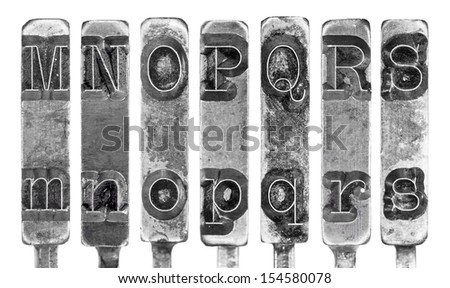 Old Typewriter Typebar Letters M to S Isolated on White - stock photo