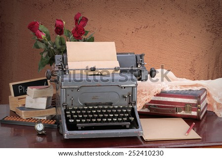 old typewriter vintage stylish typewriter with share your story text on a paper list on stylish color background ans white typewriter with paper. Can use it for advertising, banner, card, etc.  - stock photo
