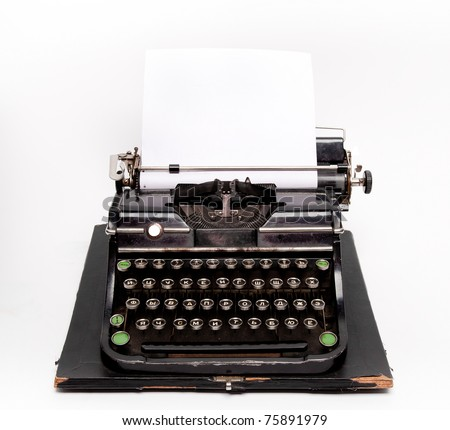 Old typewriter with a sheet of paper isolated on white background