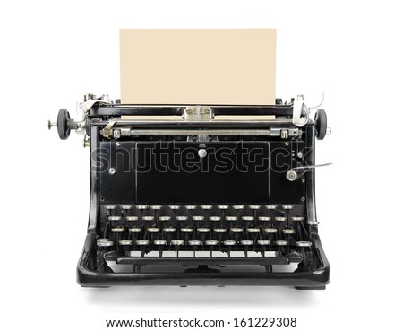 Old typewriter with blank sheet isolated on white - stock photo