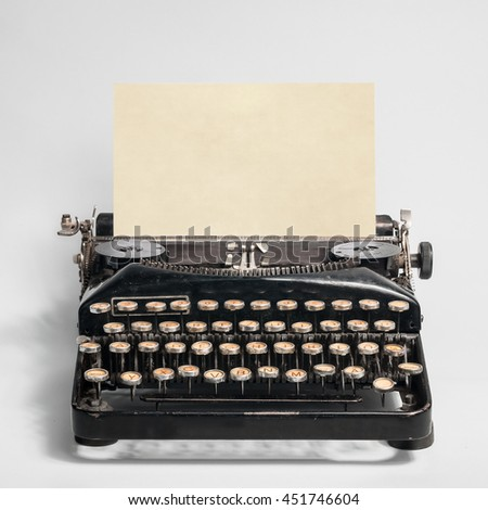 Old Typewriter with old sheet on a gray background
