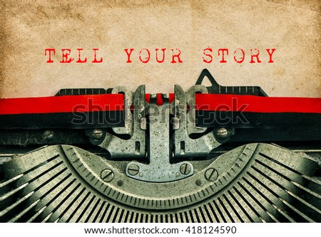 Old typewriter with sample text TELL YOUR STORY. Grungy paper background. Blogging concept - stock photo